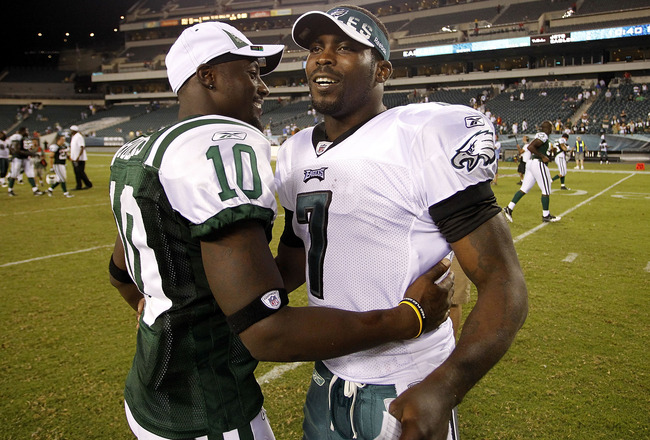 PHILADELPHIA - SEPTEMBER 02:  Michael Vick #7 of the Philadelphia Eagles hugs Santonio Holmes #10 of the New York Jets after a preseason game at Lincoln Financial Field on September 2, 2010 in Philadelphia, Pennsylvania.  (Photo by Jeff Zelevansky/Getty I