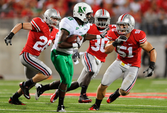 COLUMBUS, OH - SEPTEMBER 2:  Tyler Moeller #26, Brian Rolle #36 and Ross Homan #5 of the Ohio State Buckeyes pursue Courtney Edmonson #80 of the Marshall Thundering Herd  at Ohio Stadium on September 2, 2010 in Columbus, Ohio.  (Photo by Jamie Sabau/Getty