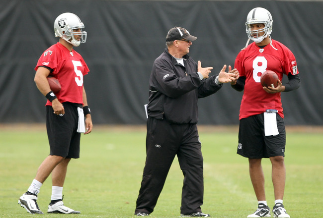 NAPA, CA - AUGUST 01:  Quarterback coach Paul Hackett speaks to Jason Campbell #8 and Bruce Gradkowski #5 of the Oakland Raiders during the Raiders training camp at their Napa Valley Training Complex on August 1, 2010 in Napa, California.  (Photo by Ezra