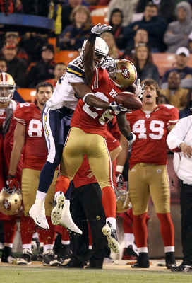 SAN FRANCISCO - SEPTEMBER 02:  Tramaine Brock #26 of the San Francisco 49ers is called for pass interference when he tried to break up a pass intended for Seyi Ajirotutu #89 of the San Diego Chargers at Candlestick Park  on September 2, 2010 in San Franci