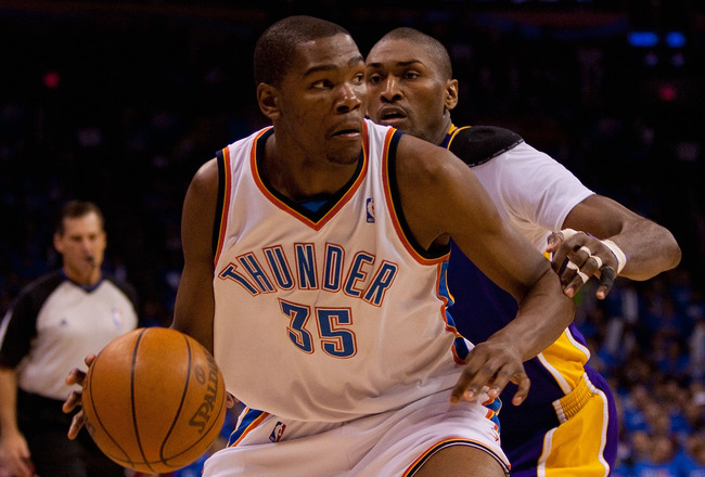 OKLAHOMA CITY - APRIL 30: Kevin Durant #35 of the Oklahoma City Thunder drives to the basket  against Ron Artest #37 of the Los Angeles Lakers during Game Six of the Western Conference Quarterfinals of the 2010 NBA Playoffs on April 30, 2010 at the Ford C