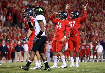 TUCSON, AZ - NOVEMBER 21:  Kicker Alex Zendejas #14 and Keenyn Crier #47 of the Arizona Wildcats celebrate kicking a field goal against the Oregon Ducks during the college football game at Arizona Stadium on November 21, 2009 in Tucson, Arizona.The Ducks