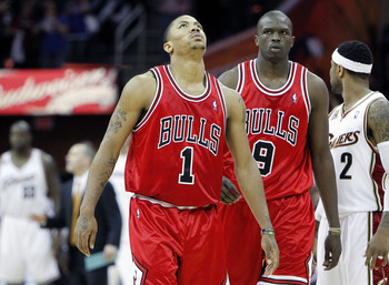 CLEVELAND - APRIL 27:  Derrick Rose #1 and Luol Deng #9 of the Chicago Bulls react late in the game while playing the Cleveland Cavaliers during Game Five of the Eastern Conference Quarterfinals during the 2010 NBA Playoffs at Quicken Loans Arena on April