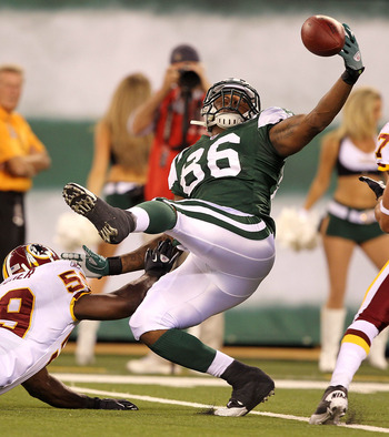EAST RUTHERFORD, NJ - AUGUST 27:  Jeff Cumberland #86 of the New York Jets cannot hang onto the ball as London Fletcher #59 of the Washington Redskins  defends during their preseason game on August 27, 2010 at the New Meadowlands Stadium  in East Rutherfo