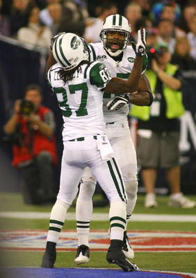 TORONTO - DECEMBER 3: Braylon Edwards #17 and David Clowney #87 of the New York Jets celebrate after Edwwards acored a 13-yard touchdown reception in the second quarter against the Buffalo Bills at Rogers Centre on December 3, 2009 in Toronto, Canada.  (P