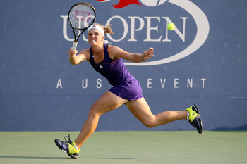 NEW YORK - SEPTEMBER 01:  Melanie Oudin of the United States returns a shot against Alona Bondarenko of the Ukraine during her women's singles second round match on day three of the 2010 U.S. Open at the USTA Billie Jean King National Tennis Center on Sep
