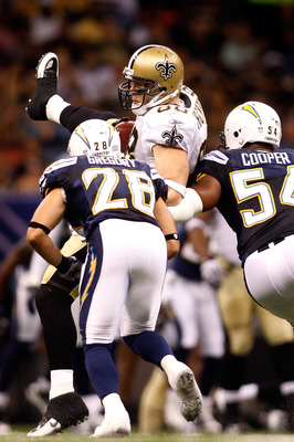 NEW ORLEANS - AUGUST 27:  Jeremy Shockey #88 of the New Orleans Saints is tackled by Steve Gregory #28 and Stephen Cooper #54 of the San Diego Chargers at the Louisiana Superdome on August 27, 2010 in New Orleans, Louisiana.  (Photo by Chris Graythen/Gett
