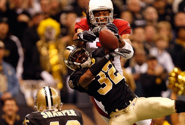 NEW ORLEANS - JANUARY 16:  Larry Fitzgerald #11 of the Arizona Cardinals fails to come a reception in the endzone against Jabari Greer #32 and Darren Sharper #42 of the New Orleans Saints during the NFC Divisional Playoff Game at Louisana Superdome on Jan