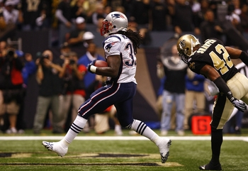 NEW ORLEANS - NOVEMBER 30: Laurence Maroney #39 of the New England Patriots scores a 4-yard rushing touchdown during the first quarter of the game against Darren Sharper #42 of the New Orleans Saints at Louisana Superdome on November 30, 2009 in New Orlea