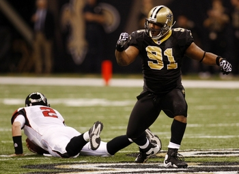 NEW ORLEANS - NOVEMBER 2:  Will Smith #91 of the New Orleans Saints celebrates sacking quarterback Matt Ryan #2 of the Atlanta Falcons during the first quarter of the game at the Louisiana Superdome on November 2, 2009 in New Orleans, Louisiana. (Photo by