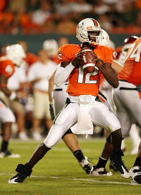 MIAMI GARDENS, FL - OCTOBER 03:  Quarterback Jacory Harris #12 of the Miami Hurricanes drops back to pass against the Oklahoma Sooners at Land Shark Stadium on October 3, 2009 in Miami Gardens, Florida. Miami defeated Oklahoma 21-20.  (Photo by Doug Benc/