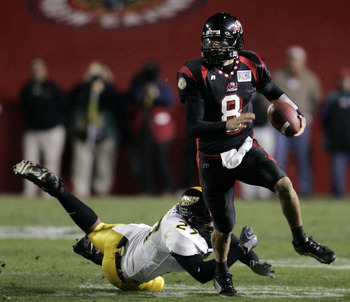 LAFAYETTE, LA - DECEMBER 20:   Quarterback Nick Noce #8 of Arkansas State avoids a tackle by Wayne Hardy #27 of Southern Miss during The New Orleans Bowl on December 20, 2005 at Cajun Field in Lafayette, Louisiana. Southern Miss defeated Arkansas State 31