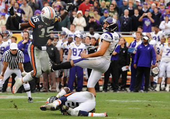 TAMPA, FL - JANUARY 1: Kicker Stefan Demos #1 of the Northwestern Wildcats follows through on a field goal attempt against the Auburn Tigers in the Outback Bowl January 1, 2010 at Raymond James Stadium in Tampa, Florida.  Auburn was called for roughing th