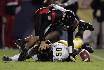 LAFAYETTE, LA - DECEMBER 20:  Quarterback Nick Noce #8 of Arkansas State fumbles the ball after being hit by Akeem Lockett #50 of Southern Miss during The New Orleans Bowl on December 20, 2005 at Cajun Field in Lafayette, Louisiana. Southern Miss defeated
