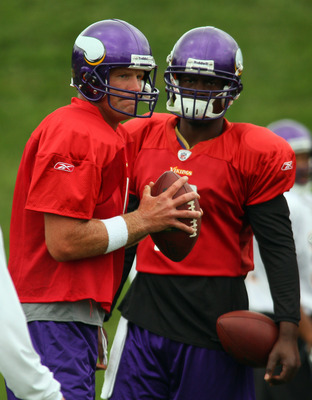 EDEN PRAIRIE, MN - AUGUST 18: Quarterbacks Brett Favre #4 and Tarvaris Jackson #7 of the Minnesota Vikings participate in Favre's first morning practice since returning to Vikings Winter Park on August 18, 2010 in Eden Prairie, Minnesota. Favre injured hi