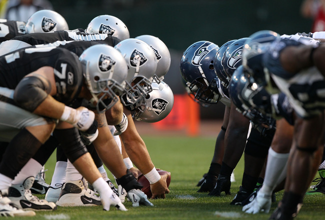 OAKLAND, CA - SEPTEMBER 2:  Members of the Seattle Seahawks line up against the Oakland Raiders during an NFL preseason game at Oakland-Alameda County Coliseum on September 2, 2010 in Oakland, California.  (Photo by Jed Jacobsohn/Getty Images)