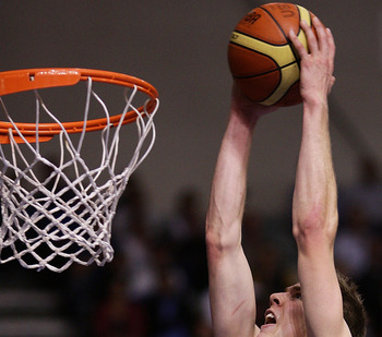 AUCKLAND, NEW ZEALAND - NOVEMBER 12:  Thomas Abercrombie of the Breakers dunks the ball during the round eight NBL match between the New Zealand Breakers and the Perth Wildcats at North Shore Events Centre on November 12, 2009 in Auckland, New Zealand.  (