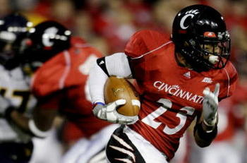 CINCINNATI - NOVEMBER 13:  Isaiah Pead #23 of the Cincinnati Bearcats carries the ball against the West Virginia Mountaineers in the fourth quarter of the game at Nippert Stadium on November 13, 2009 in Cincinnati, Ohio.  (Photo by Andy Lyons/Getty Images