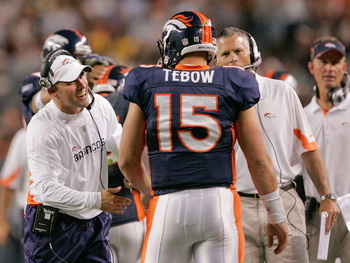 DENVER - AUGUST 29: Head coach Josh McDaniels of the Denver Broncos congratulates quarterback Tim Tebow #15 following his fourth quarter touchdown pass against the Pittsburgh Steelers at INVESCO Field at Mile High on August 29, 2010 in Denver, Colorado.