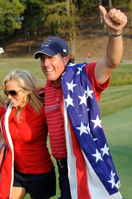 LOUISVILLE, KY - SEPTEMBER 21:  Phil Mickelson of the USA team celebrates with his wife Amy after the USA 16 1/2 - 11 1/2 victory on the final day of the 2008 Ryder Cup at Valhalla Golf Club on September 21, 2008 in Louisville, Kentucky.  (Photo by Sam Gr