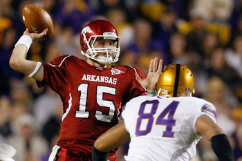 BATON ROUGE, LA - NOVEMBER 28:  Quarterback Ryan Mallett #15 of the Arkansa Razorbacks throws a pass over Rahim Alem #84 of the Louisiana State University Tigers at Tiger Stadium on November 28, 2009 in Baton Rouge, Louisiana.  (Photo by Chris Graythen/Ge