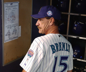 PHOENIX - APRIL 6:  Manager Bob Brenly #15 of the Arizona Diamondbacks watches the Opening Day game against the Colorado Rockies at Bank One Ballpark on April 6, 2004 in Phoenix, Arizona.  The Rockies defeated the Diamondbacks 6-2. (Photo by Barry Gossage