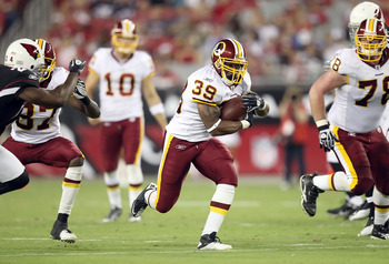 Redskins back, Willie parker Rushes against the cardinals thursday night.