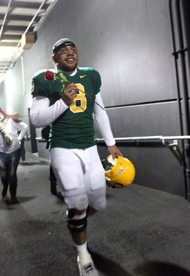 EUGENE, OR - DECEMBER 3:  Quarterback Jeremiah Masoli #8 of the Oregon Ducks celebrates their Civil War victory over Oregon State holding a rose at Autzen Stadium on December 3, 2009 in Eugene, Oregon. The Ducks defeated the Beavers 37-33. (Photo by Tom H