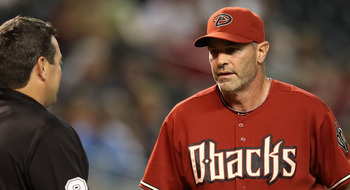 PHOENIX - AUGUST 04:  Manager Kirk Gibson of the Arizona Diamondbacks talks with home plate umpire Rob Drake during a pitching change in the Major League Baseball game against the Washington Nationals at Chase Field on August 4, 2010 in Phoenix, Arizona.