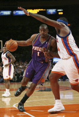 NEW YORK - JANUARY 24:  Amare Stoudemire #1 of the Phoenix Suns drives against Eddy Curry #34 of the New York Knicks January 24, 2007 at Madison Square Garden in New York City. NOTE TO USER: User expressly acknowledges and agrees that, by downloading and