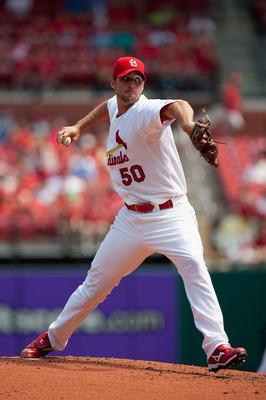 ST. LOUIS - AUGUST 18: Starting pitcher Adam Wainwright #50 of the St. Louis Cardinals throws to first base against the Milwaukee Brewers  at Busch Stadium on August 18, 2010 in St. Louis, Missouri.  The Brewers beat the Cardinals 3-2.  (Photo by Dilip Vi