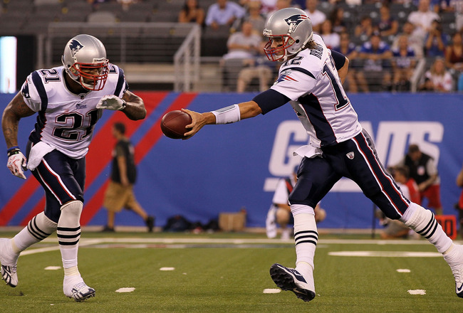 EAST RUTHERFORD, NJ - SEPTEMBER 02:  Tom Brady #12 of the New England Patriots hands off the ball against the New York Giants to teammate Fred Taylor #21 on September 2, 2010 at the New Meadowlands Stadium in East Rutherford, New Jersey.  (Photo by Jim Mc