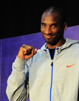 GUANGZHOU, CHINA - JULY 29:  (CHINA OUT) NBA player Kobe Bryant of the Los Angeles Lakers pumps his fist during a meet and greet with fans at Jinan University on July 29, 2010 in Guangzhou, Guangdong Province of China.  (Photo by ChinaFotoPress/Getty Imag