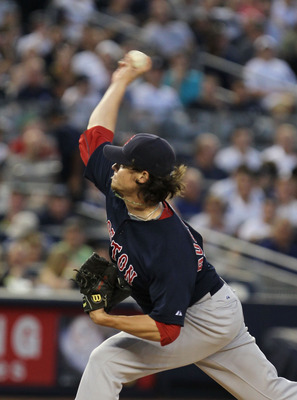 NEW YORK - AUGUST 06:  Clay Buchholz #11 of the Boston Red Sox pitches against the New York Yankees on August 6, 2010 at Yankee Stadium in the Bronx borough of New York City.  (Photo by Al Bello/Getty Images)