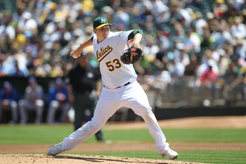 OAKLAND, CA - AUGUST 08:  Trevor Cahill #53 of the Oakland Athletics pitches against the Texas Rangers during an MLB game at the Oakland-Alameda County Coliseum on August 8, 2010 in Oakland, California.  (Photo by Jed Jacobsohn/Getty Images)