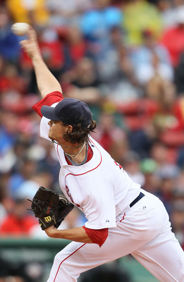 BOSTON - AUGUST 22:  Clay Buchholz #11 of the Boston Red Sox delivers a pitch in the first inning against the Toronto Blue Jays on August 22, 2010 at Fenway Park in Boston, Massachusetts.  (Photo by Elsa/Getty Images)