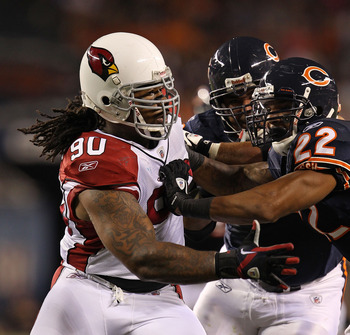 CHICAGO - AUGUST 28: Darnell Dockett #90 of the Arizona Cardinals rushes against Matt Forte #22 and Johan Asiata #62 of the Chicago Bears during a preseason game at Soldier Field on August 28, 2010 in Chicago, Illinois. The Cardinals defeated the Bears 14
