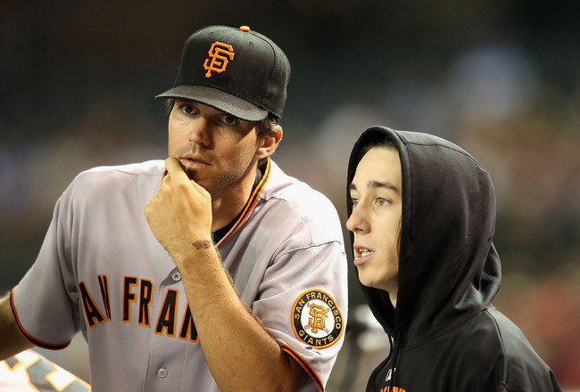 PHOENIX - MAY 20:  Pitchers Barry Zito #75 and Tim Lincecum #55 of the San Francisco Giants talk in the dugout during the Major League Baseball game against the Arizona Diamondbacks at Chase Field on May 20, 2010 in Phoenix, Arizona.  (Photo by Christian