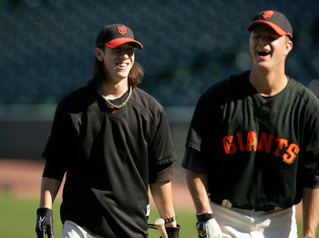 SAN FRANCISCO - AUGUST 26:  Tim Lincecum #55 of the San Francisco Giants jokes with Matt Cain #18 during batting practice before their game against the Arizona Diamondbacks at AT&T Park on August 26, 2009 in San Francisco, California.  (Photo by Ezra Shaw