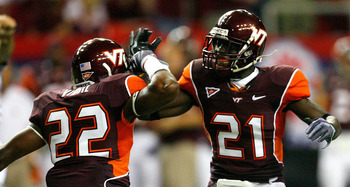 ATLANTA - SEPTEMBER 05:  Stephan Virgil #22 and Rashad Carmichael #21 of the Virginia Tech Hokies celebrate a defensive stop against the Alabama Crimson Tide during the Chick-fil-A Kickoff Game at Georgia Dome on September 5, 2009 in Atlanta, Georgia.  (P