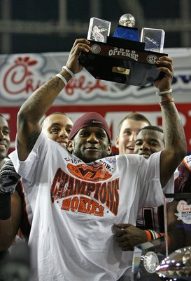 ATLANTA - DECEMBER 31:  Tailback Ryan Williams #34 of the Virginia Tech Hokies raises the Most Outstanding Offensive Player trophy after the Chick-fil-A Bowl against the Tennessee Volunteers at the Georgia Dome on December 31, 2009 in Atlanta, Georgia.  V