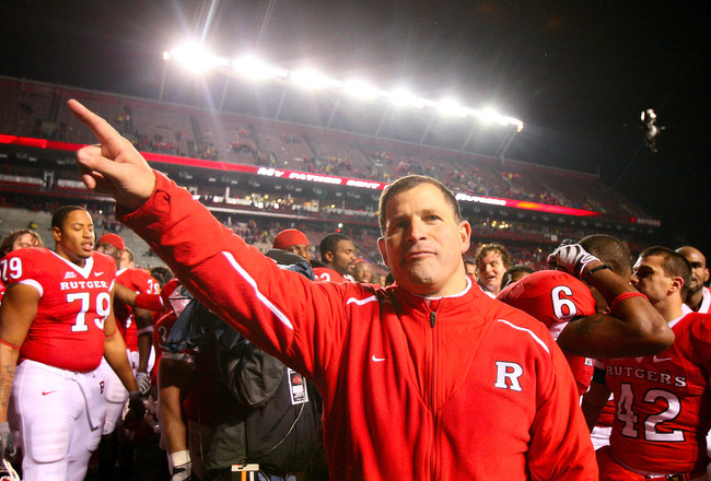 PISCATAWAY, NJ - DECEMBER 04:  Greg Schiano head coach of the Rutgers Scarlet Knights celebrates victory over the Louisville Cardinals at Rutgers Stadium on December 4, 2008 in Piscataway, New Jersey.  (Photo by Jim McIsaac/Getty Images)