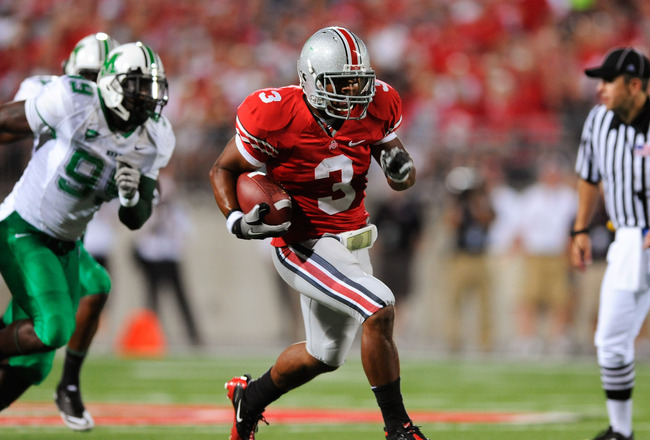 COLUMBUS, OH - SEPTEMBER 2:  Brandon Saine #3 of the Ohio State Buckeyes takes off on a 45-yard touchdown run in the second quarter against the Marshall Thundering Herd at Ohio Stadium on September 2, 2010 in Columbus, Ohio.  (Photo by Jamie Sabau/Getty I