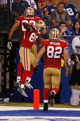 INDIANAPOLIS, IN - AUGUST 15: Tony Curtis #89, Nate Byham #82 and Jason Hill #89 of the San Francisco 49ers jump in the air to celebrate a touchdown during the preseason game against the Indianapolis Colts at Lucas Oil Stadium on August 15, 2010 in Indian
