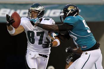 PHILADELPHIA - AUGUST 13: Brent Celek #87 of the Philadelphia Eagles has his reception broken up in the endzone by Justin Durrant #56 of the Jacksonville Jaguars during their preseason game at Lincoln Financial Field on August 13, 2010 in Philadelphia, Pe