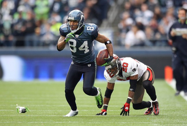SEATTLE - DECEMBER 20:  T.J. Houshmandzadeh #84 of the Seattle Seahawks runs with the ball for yardage with one shoe on during their game against the Tampa Bay Buccaneers on December 20, 2009 at Qwest Field in Seattle, Washington. The Buccaneers defeated