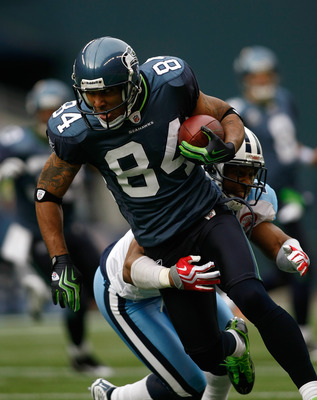 SEATTLE , WA - JANUARY 03:  T.J. Houshmandzadeh #84 of the Seattle Seahawks runs after making a catch against Rod Hood #37 of the Tennessee Titans at Qwest Field on January 3, 2010 in Seattle, Washington.  (Photo by Jonathan Ferrey/Getty Images)