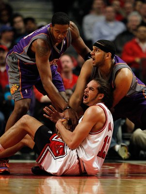 CHICAGO - MARCH 30: Joakim Noah #13 of the Chicago Bulls battles for the ball with Jared Dudley #3 and Channing Frye #8 of the Phoenix Suns at the United Center on March 30, 2010 in Chicago, Illinois. The Suns defeated the Bulls 111-105. NOTE TO USER: Use