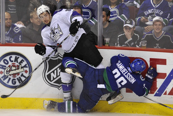 VANCOUVER, CANADA - APRIL 23:  Mikael Samuelsson #26 of the Vancouver Canucks falls to the ice after colliding with Drew Doughty #8 of the Los Angeles Kings during the second period in Game Five of the Western Conference Quarterfinals during the 2010 NHL