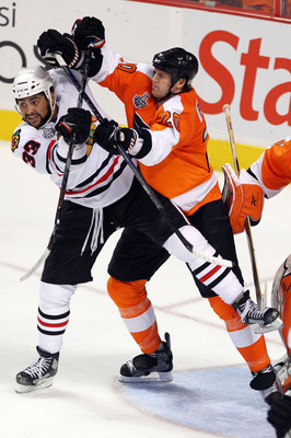 PHILADELPHIA - JUNE 04:  Dustin Byfuglien #33 of the Chicago Blackhawks and Chris Pronger #20 of the Philadelphia Flyers cross sticks in Game Four of the 2010 NHL Stanley Cup Final at Wachovia Center on June 4, 2010 in Philadelphia, Pennsylvania.  (Photo